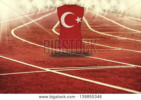 Red Running Track With Lines And Turkey Flag On Shirt