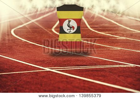 Red Running Track With Lines And Uganda Flag On Shirt