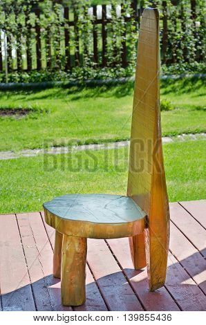 Wooden chair as a variant of garden decor