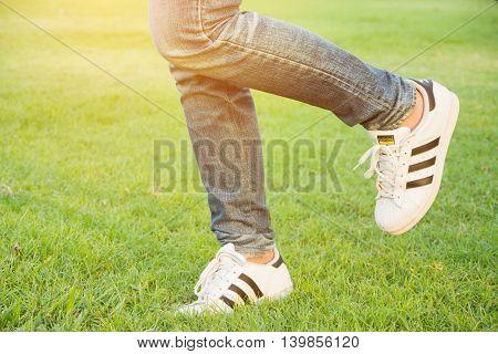 Bangkok Thailand - July 25 2016 : Woman walking at Adidas superstar shoes on white