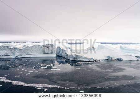 icebergs are on the arctic ocean at Ilulissat fjord in Greenland