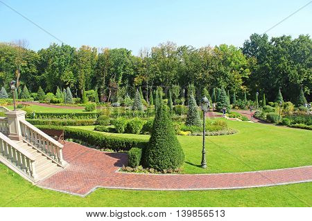 KYIV, UKRAINE - SEPTEMBER 14, 2014: Mezhyhirya - former private residence of ex-president Yanukovich, now open to the public, Kyiv region, Ukraine. Park near building