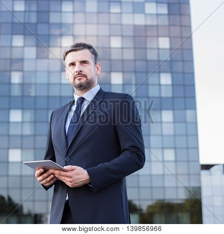 Businessman With Tablet