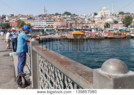Fisherman On Bridge Over Golden Horn In Istanbul