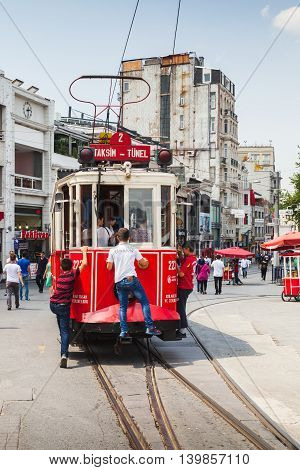 Vintage Red Tram Goes On Taksim Square In Istanbul