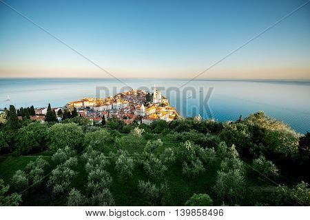 Aerial city scape view on Piran town with church tower and Adriatic sea in Slovenia. General plan with copy space