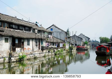 The old and weathered buildings lining the water canals of Fengjing Town in Shanghai China.
