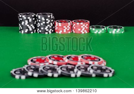 Green Casino Table With Red And Black Chips