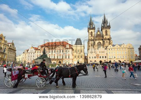 Prague, Czech Republic - October 13, 2014: Old-fashioned Coach And Coachman At The Old Town Square