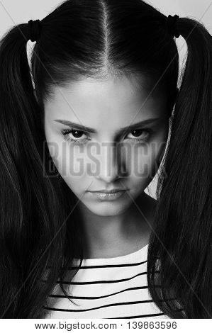 angry little girl fashion model with pigtails