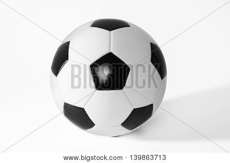 Black and white soccer ball with shadow.