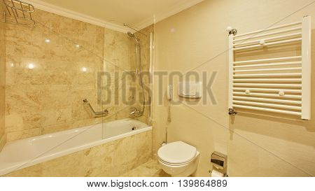 Luxury bathroom with mirrors, sink, shower and toilet.