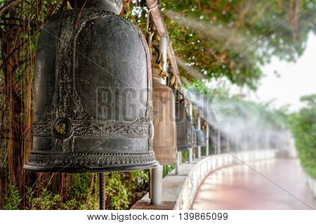 Bell ancient on the way of the Golden mount temple in the twilight of morning Bangkok Thailand. Soft focus.
