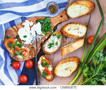 Bruschetta with feta cheese and fried tomatoes