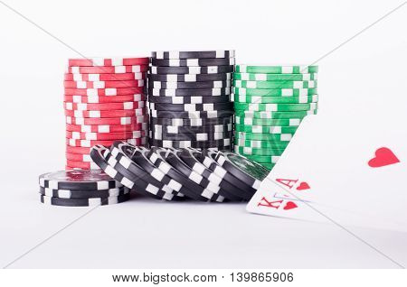 Black, Red And Green Casino Chips Isolated On White