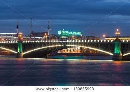 SAINT PETERSBURG, RUSSIA - JUNE 18, 2016: Advertising of the Savings Bank of Russia over the Trinity bridge in june night. Tourist landmark of the city Saint Petersburg