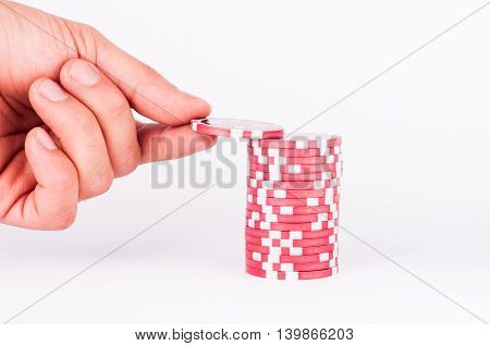 Human Hand Takeing Red Casino Chips Isolated On White