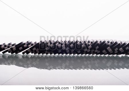 Black Casino Chips On Glass Table Isolated On White