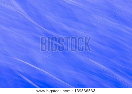 Abstract blue background with slim white lines.