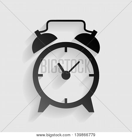 Alarm clock sign. Black paper with shadow on gray background.