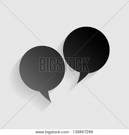 Speech bubble sign. Black paper with shadow on gray background.