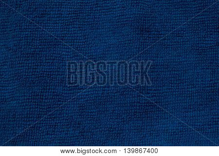 Closeup blue microfiber cloth and blue microfiber texture of microfiber towel for design with copy space for text or image.