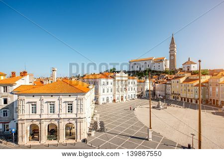 Tartini main square with church tower in Piran town at the morning in Slovenia