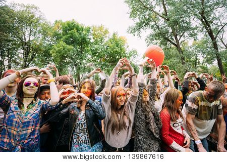 Gomel, Belarus - September 12, 2015: Young people having fun and dancing together at Holi color festival in park