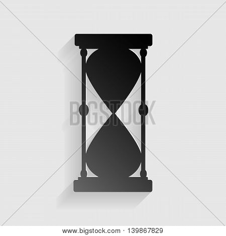 Hourglass sign illustration. Black paper with shadow on gray background.