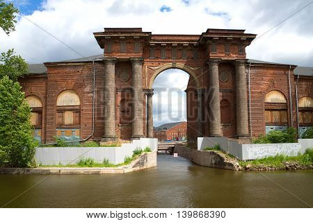 Old arch of the New Holland, day in June. View from the Moika river embankment, Saint Petersburg