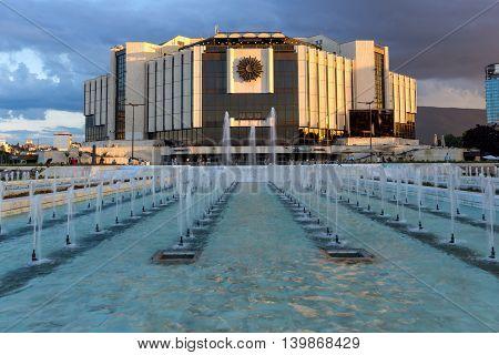 SOFIA, BULGARIA - JULY 3, 2016: Last Rays of sun over National Palace of Culture in Sofia, Bulgaria