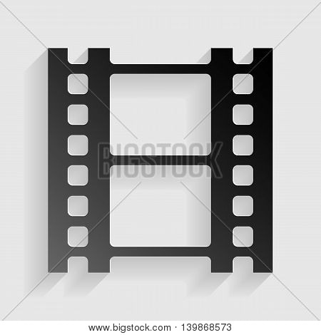 Reel of film sign. Black paper with shadow on gray background.