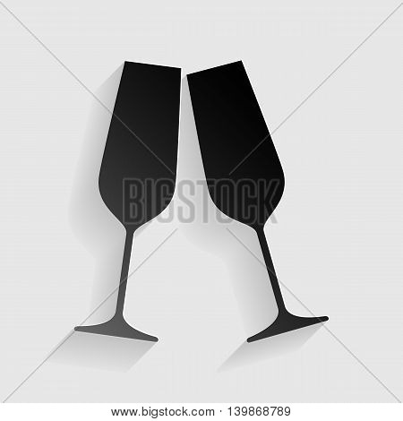 Sparkling champagne glasses. Black paper with shadow on gray background.