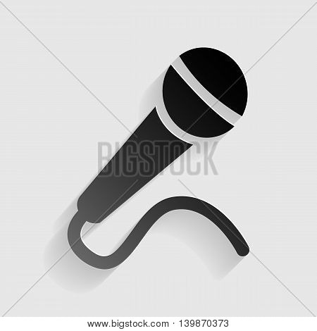 Microphone sign illustration. Black paper with shadow on gray background.