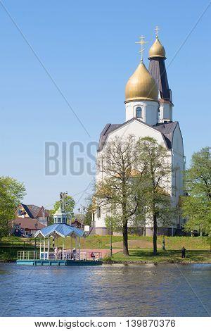 SESTRORETSK, RUSSIA - MAY 15, 2016: Peter and Paul Church on the lake Sestroretsky Razliv, sunny may day. Religious landmark  of the city Sestroretsk, Russia