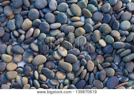 multicolored river rocks in a stone bed