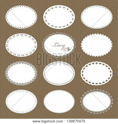 Oval lacy doilies big set on cardboard background.