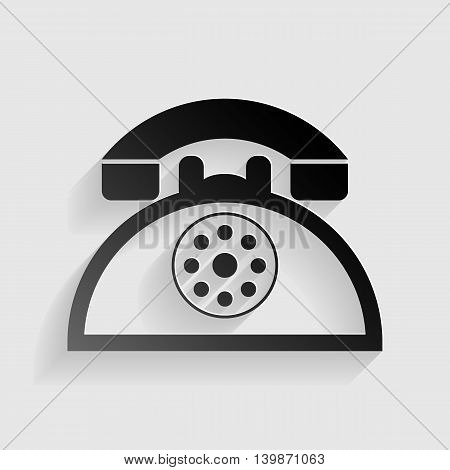 Retro telephone sign. Black paper with shadow on gray background.
