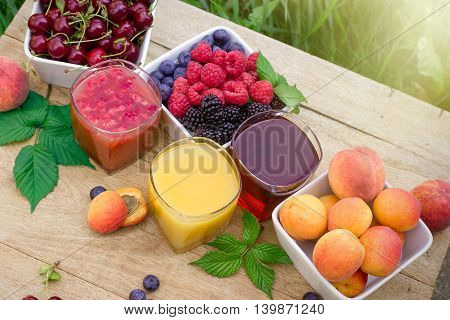Healthy fruit juice - smoothie and organic fruits on table