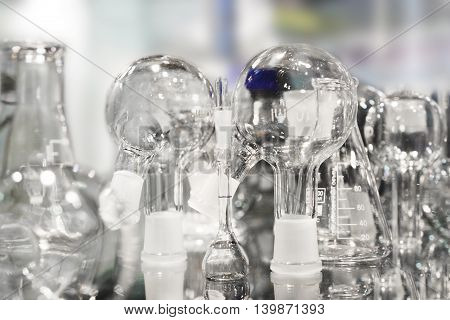 Chemical laboratory glassware. Abstract background. Shallow depth of field.