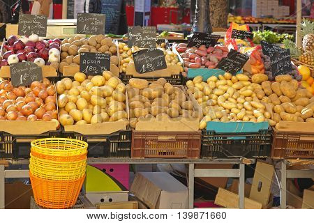 Potatoes and Onions at Farmers Market Stall