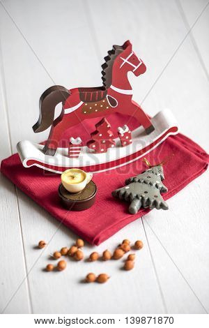 Wooden horse on a red napkin new year's attribute