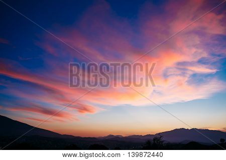 Beautiful Colorful Sunset, Sunrise  over Mountains Background. Blue, Red, Yellow Colors Sky.
