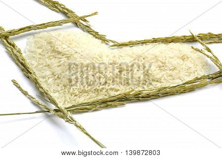 Close Up Jasmne Rice Laid Out In A Heart Shape Surround With Ear Of Rice Isolated On White Backgroun