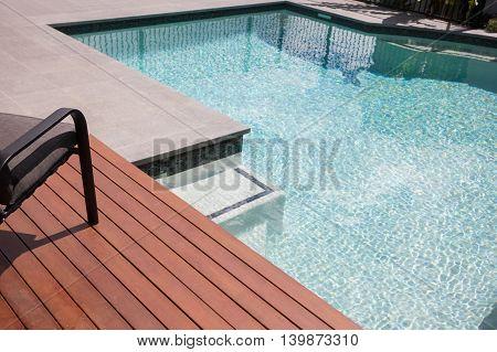 Swimming Pool Waterside Floor Area With Wooden Bars