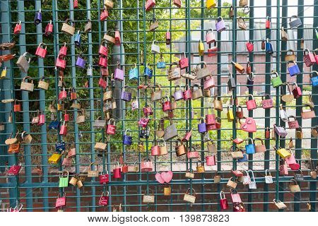 colorful love locks on the fence as concept for love