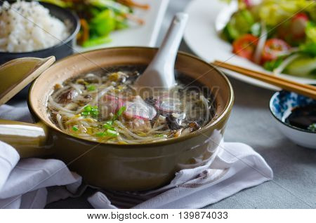 Bean sprouts soup with vegetables, meat and fish