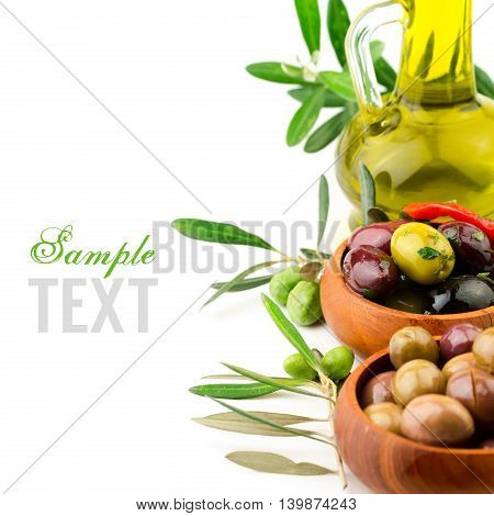 Marinated olives with oil in white background