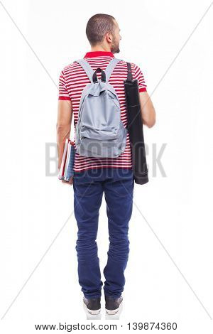 Rear view of a male student standing with backpack and notebooks on white background