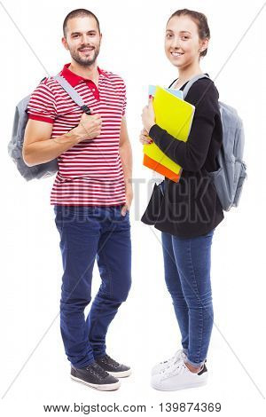 Full body portrait of students with backpack and notebooks on white background